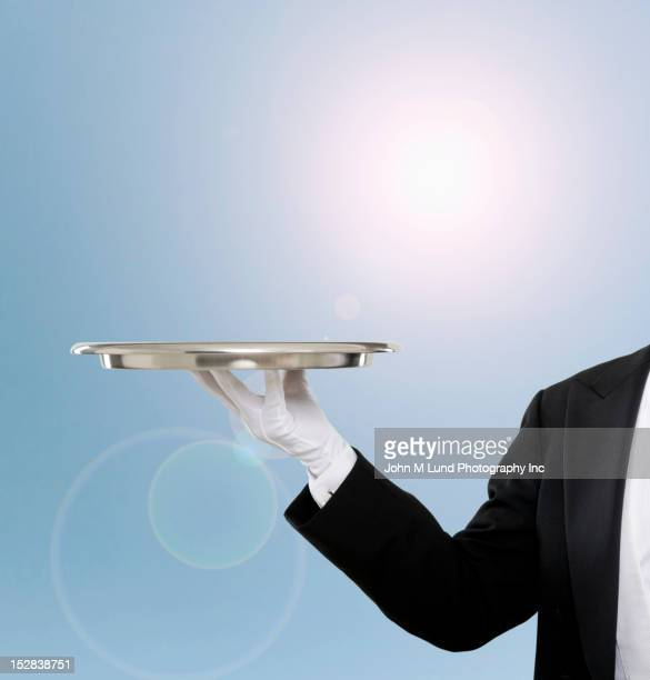 caucasian butler holding empty tray - white glove stock pictures, royalty-free photos & images