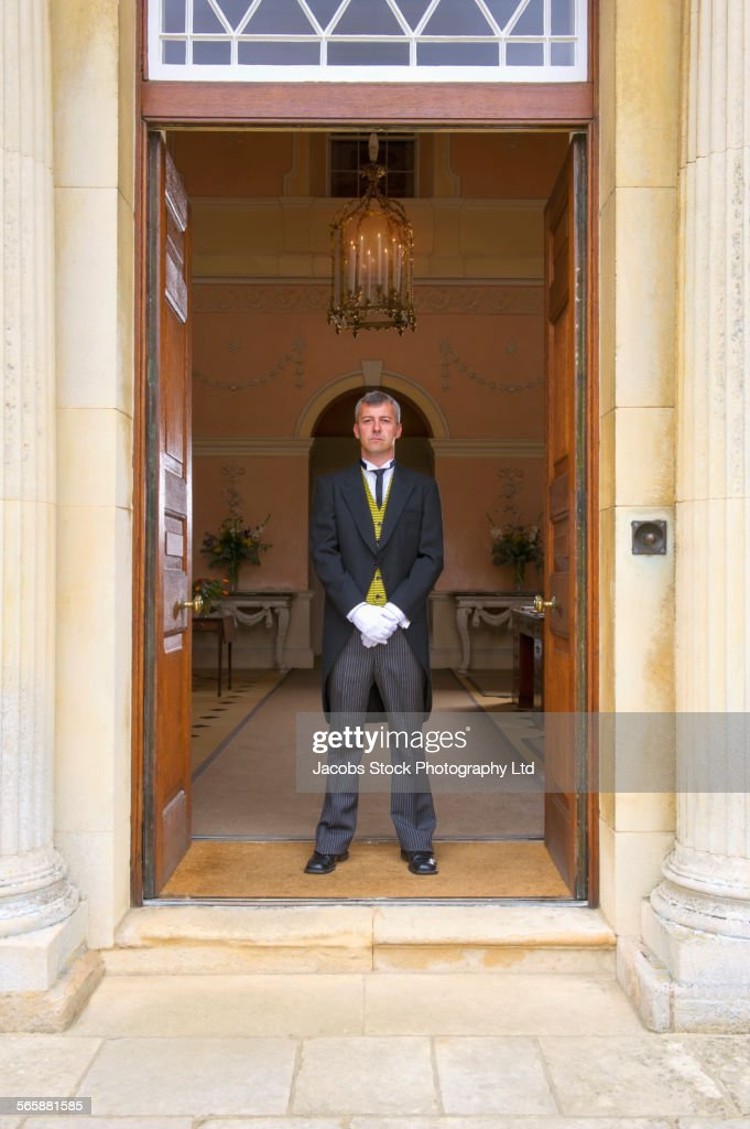 Caucasian butler standing at mansion front door  Stock Photo & Caucasian Butler Standing At Mansion Front Door Stock Photo ...