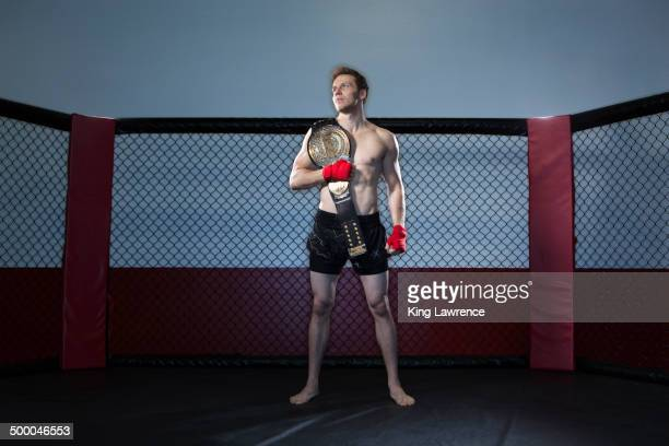 caucasian cage fighter holding championship belt - world title stock pictures, royalty-free photos & images