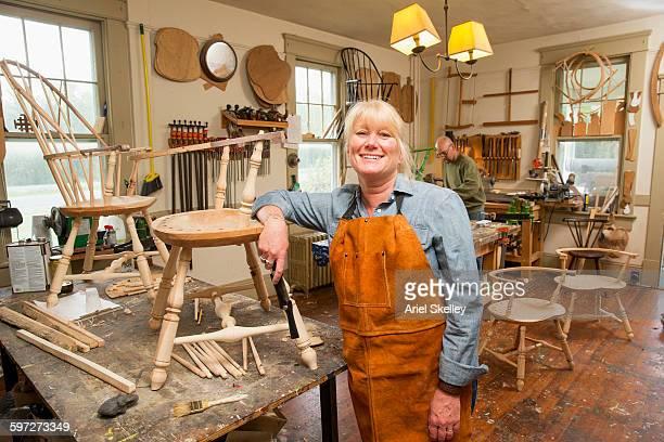 Caucasian carpenter building chair in workshop
