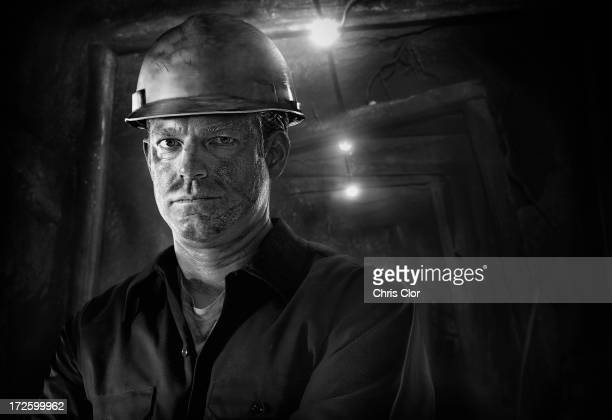 caucasian carpenter wearing hard hat - coal miner stock photos and pictures