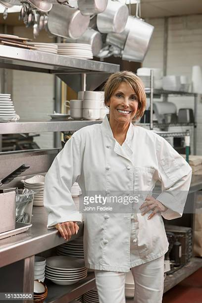 Caucasian chef standing in commercial kitchen