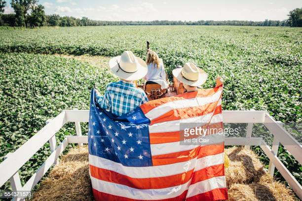 caucasian children holding american flag on hay ride - independence day holiday stock photos and pictures