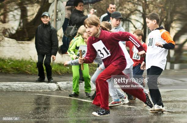 Caucasian children racing on street