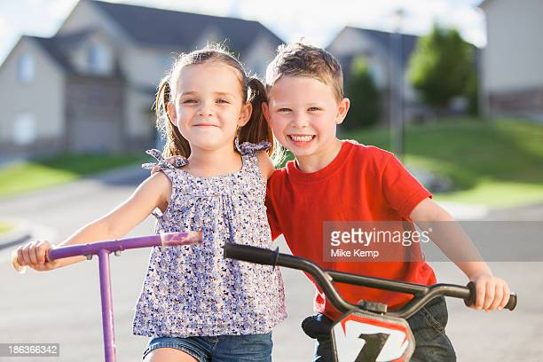 Caucasian children smiling outdoors