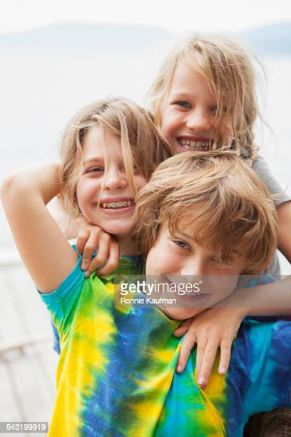 Caucasian children smiling together outdoors