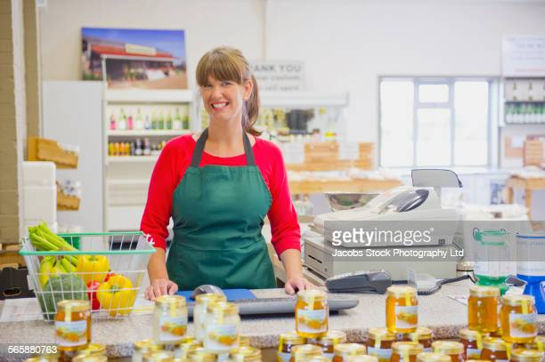 Caucasian clerk working in grocery store