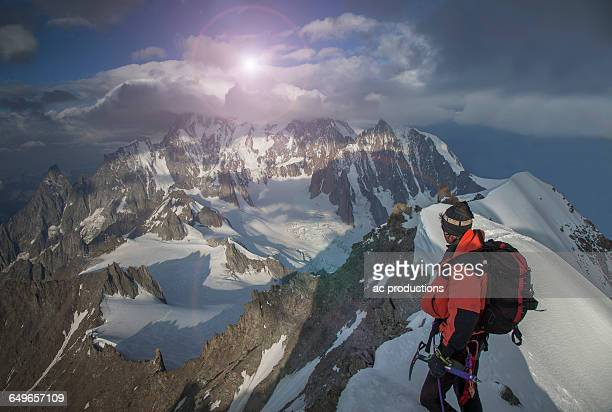 Caucasian climber admiring view from remote mountain top