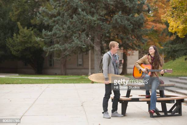 Caucasian college students talking on campus