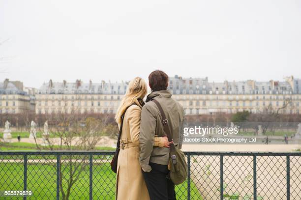 Caucasian couple admiring historical building, Paris, Ile-de-France, France