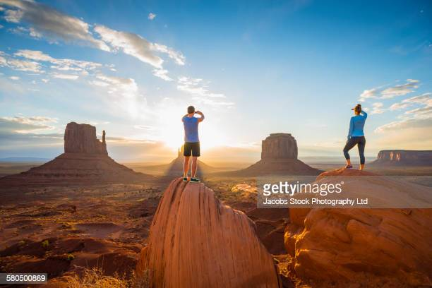 Caucasian couple admiring Monument Valley, Utah, United States