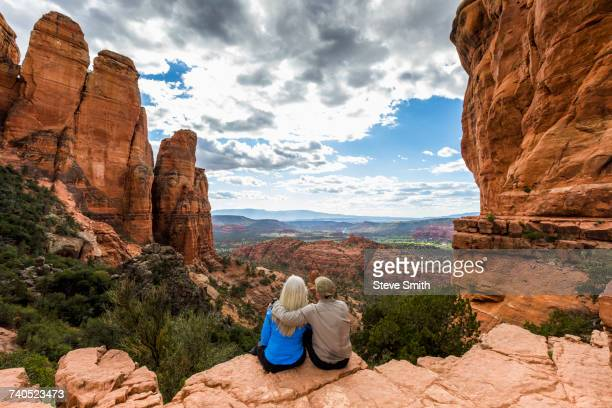 caucasian couple admiring scenic view in desert landscape - arizona stock pictures, royalty-free photos & images
