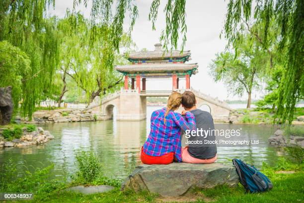 Caucasian couple admiring traditional bridge, Beijing Municipality, China