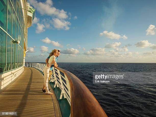 caucasian couple admiring view from boat deck - deck stock pictures, royalty-free photos & images
