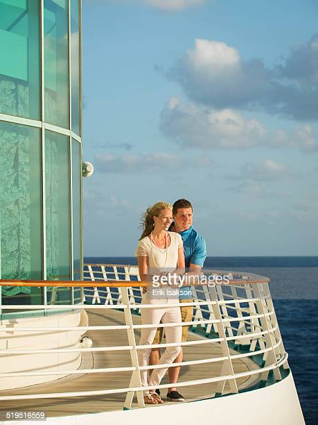 caucasian couple admiring view from boat deck - ship front view stock-fotos und bilder