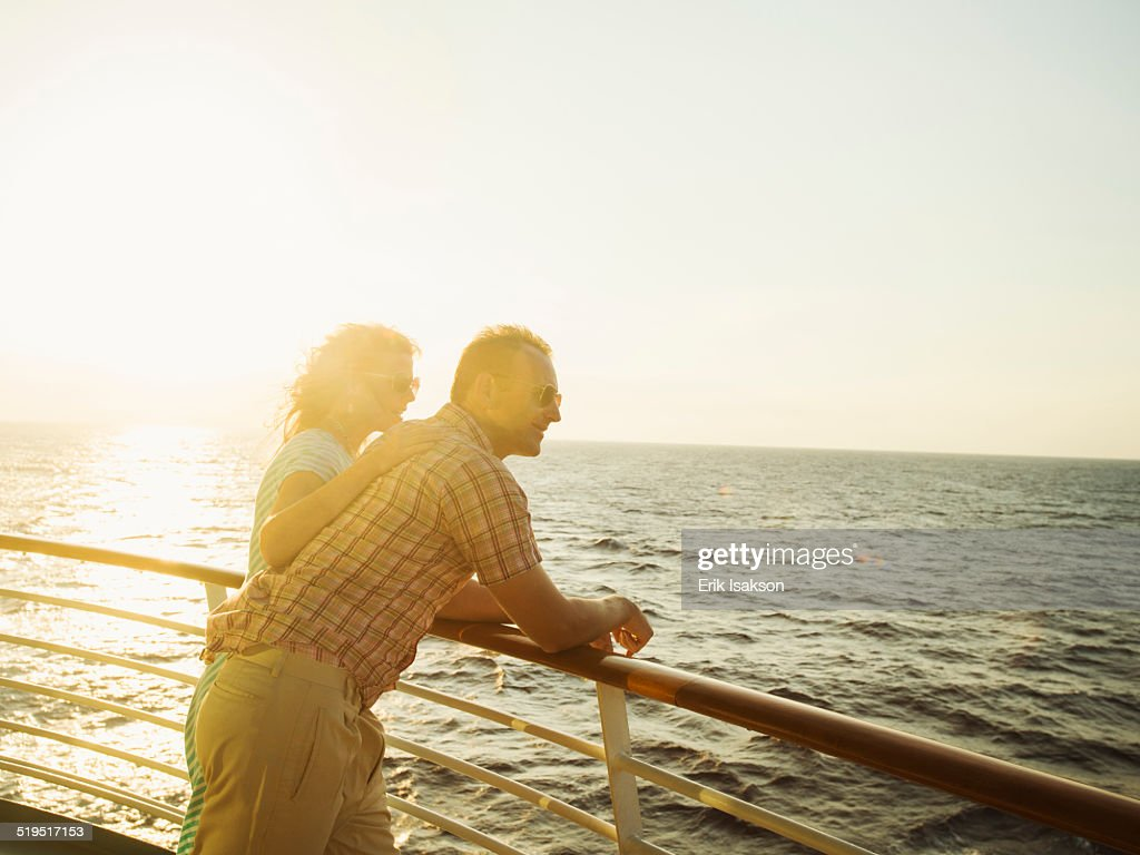 Caucasian couple admiring view from boat deck : Foto stock