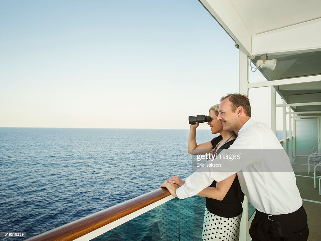 Caucasian couple admiring view from boat deck : Foto de stock