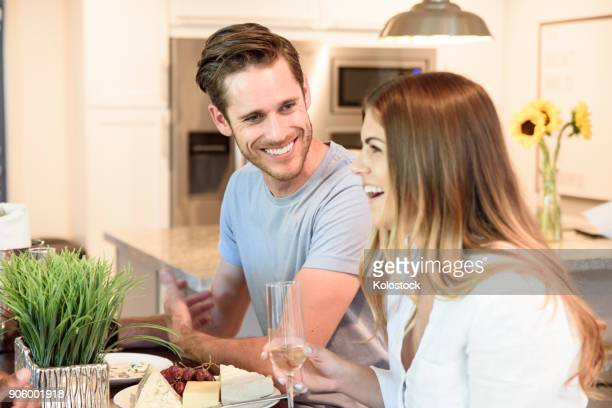 Caucasian couple drinking champagne and laughing