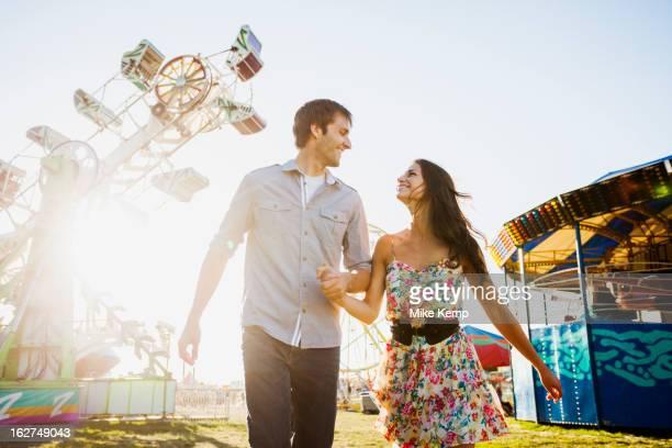 caucasian couple enjoying carnival - 遊園地 ストックフォトと画像