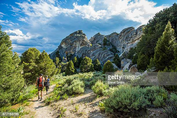 caucasian couple hiking toward mountain - idaho stock pictures, royalty-free photos & images