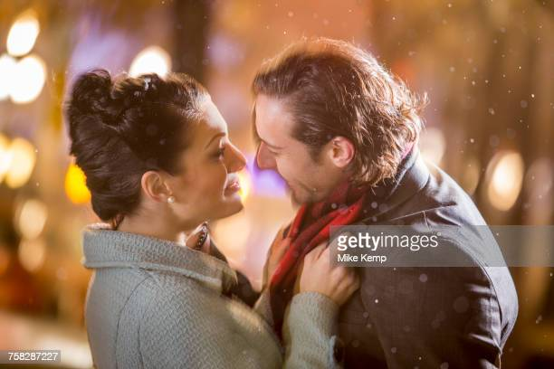 caucasian couple hugging outdoors at night - couples kissing shower stock pictures, royalty-free photos & images