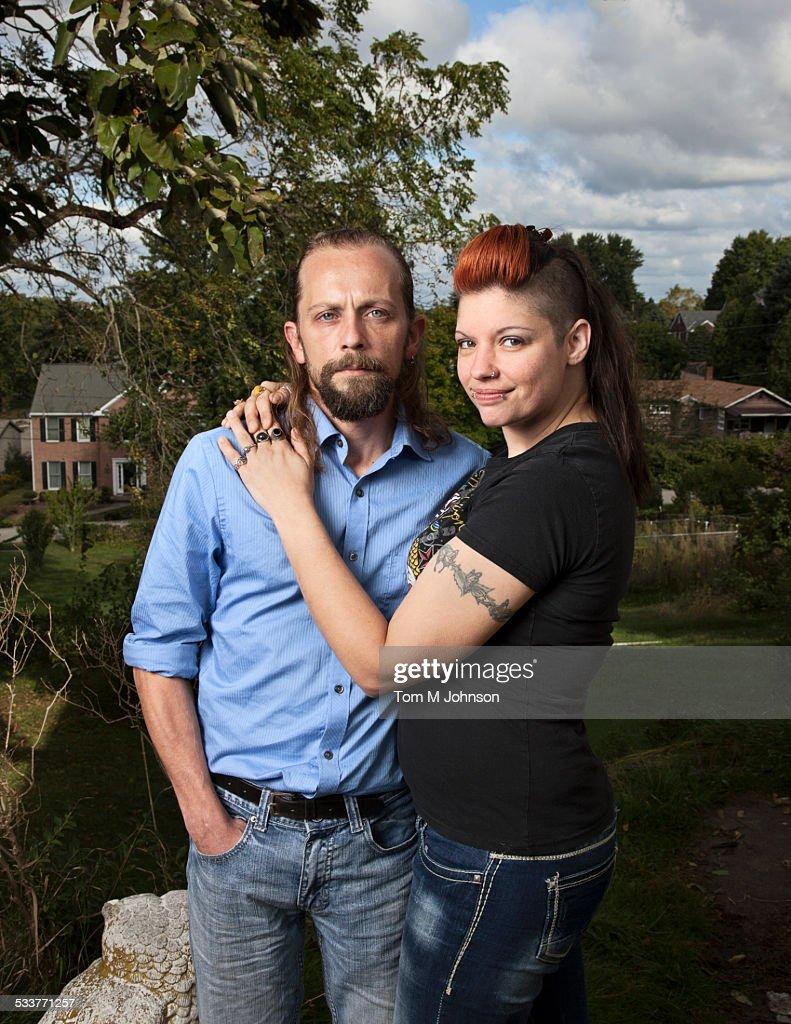 Caucasian couple hugging outdoors : Foto stock