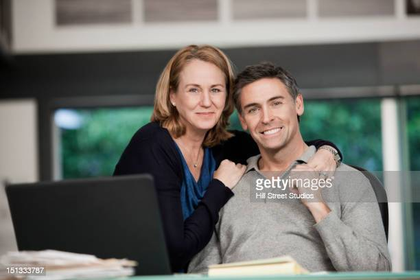 Caucasian couple hugging