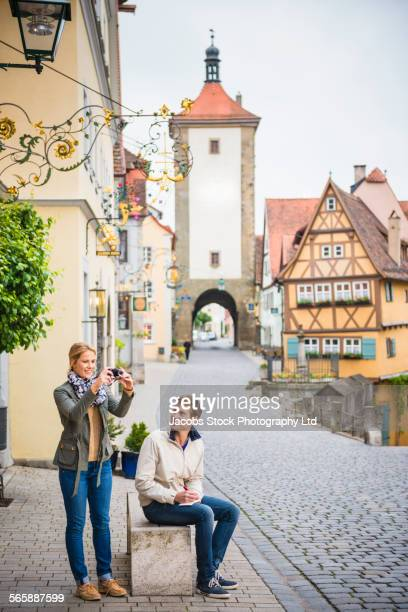 Caucasian couple photographing city