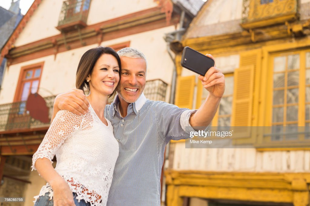 Caucasian Couple Posing For Cell Phone Selfie Stock Photo