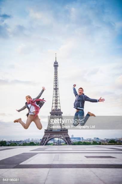 Caucasian couple posing near Eiffel Tower, Paris, France