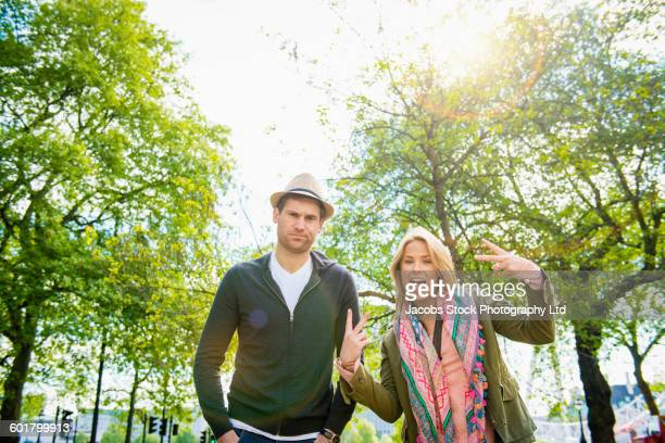 Caucasian couple posing outdoors
