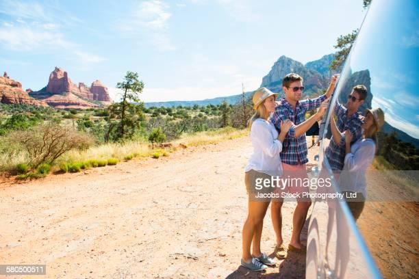 Caucasian couple reading map on road trip, Sedona, Arizona, United States