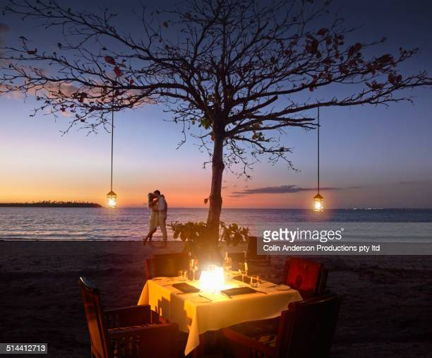 Caucasian couple relaxing at beach restaurant
