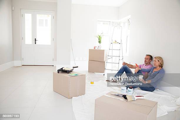 Caucasian couple relaxing in new home