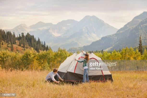 caucasian couple setting up tent - park city utah stock pictures, royalty-free photos & images