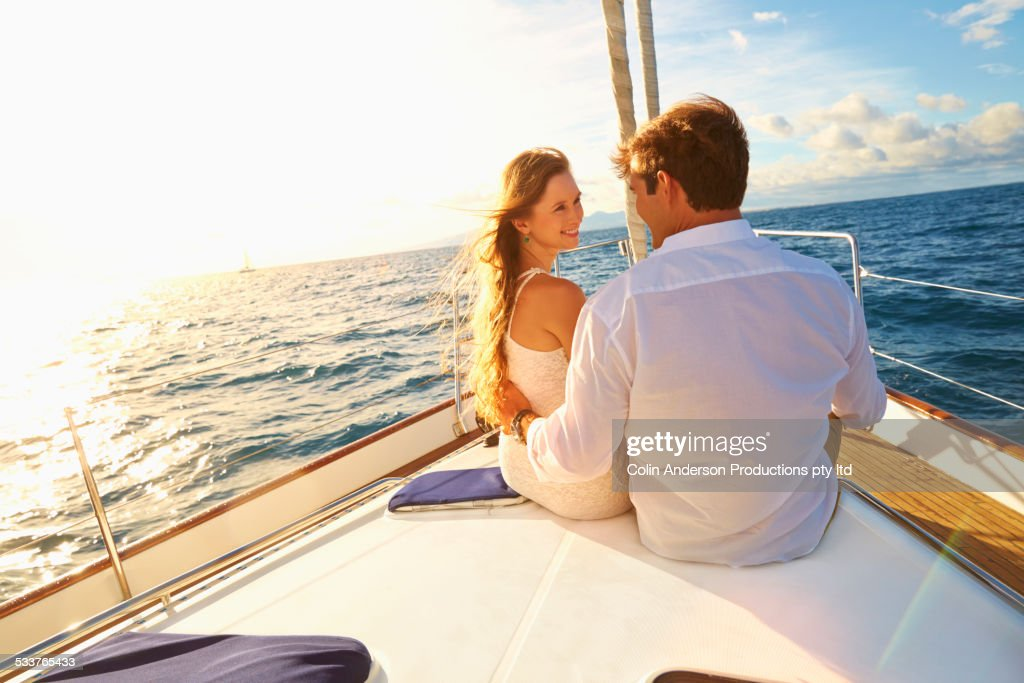 Caucasian couple sitting on yacht deck : Foto stock