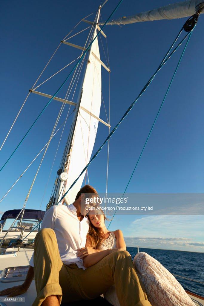 Caucasian couple sitting on yacht deck : Foto stock