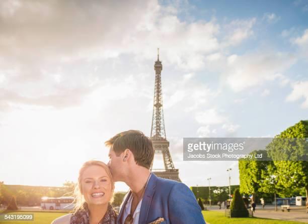 Caucasian couple smiling near Eiffel Tower, Paris, France