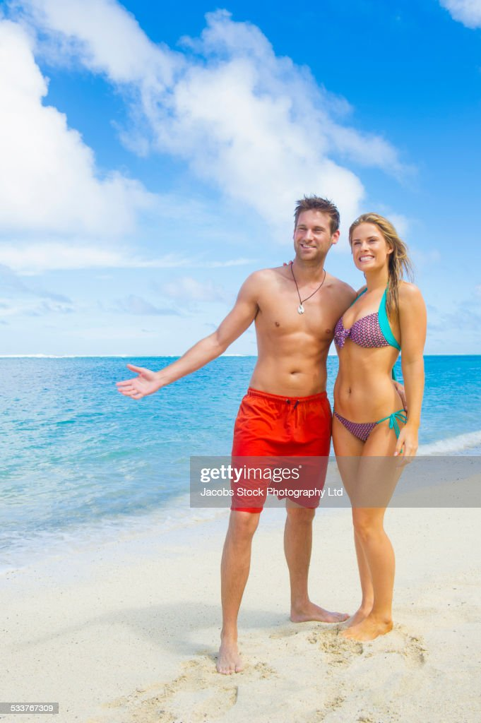 Caucasian couple smiling on beach : Foto stock