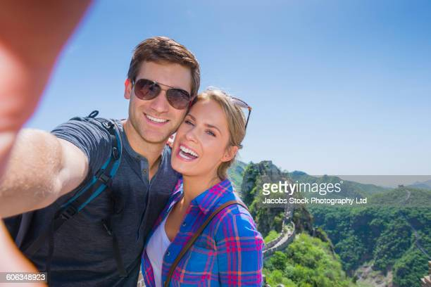 Caucasian couple smiling on Great Wall of China, Beijing, Hebei Province, China