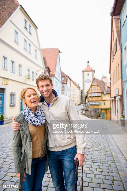 Caucasian couple standing in city