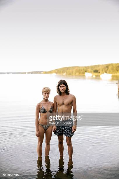 Caucasian couple standing in Lake
