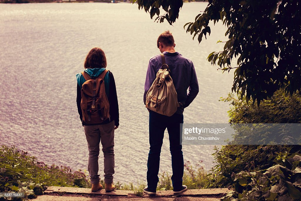 Caucasian couple standing near lake : Foto stock