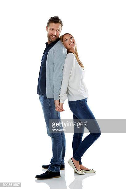 Caucasian couple standing on white