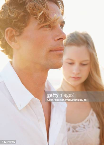 Caucasian couple standing outdoors