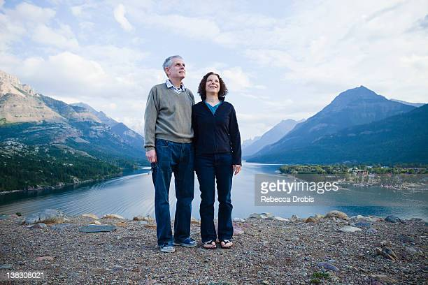 Caucasian couple standing outdoors with mountains in background
