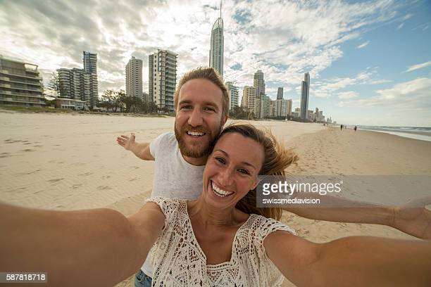 Caucasian couple take a selfie portrait at Surfer's paradise beach
