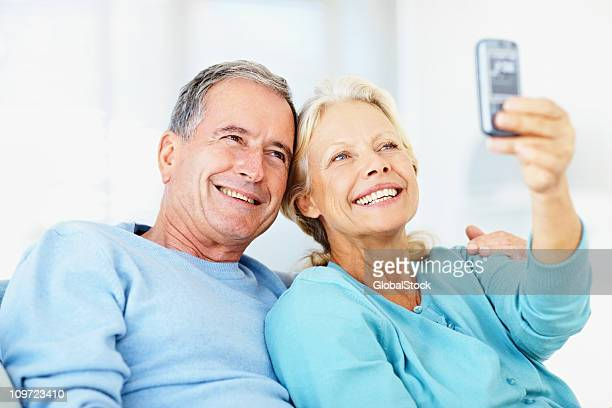 Caucasian couple taking picture of themselves