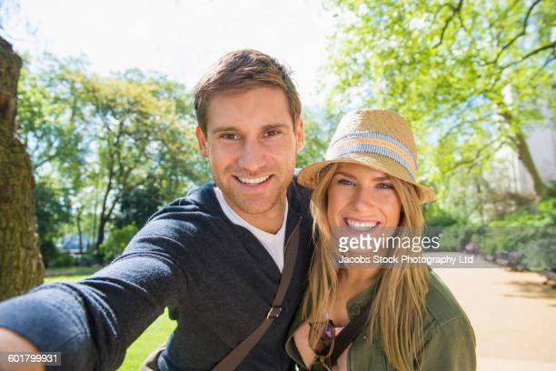 Caucasian couple taking selfie outdoors