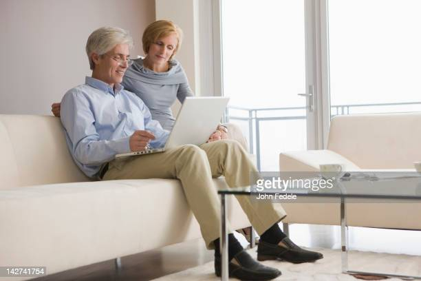 Caucasian couple using laptop together